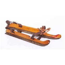 Antique wood and iron ice skates.  SIZE: see attached r