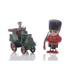 Two(2) vintage tin toys of English Queen's guard and ol