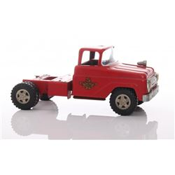 Vintage red colored toy truck with one spot light mount