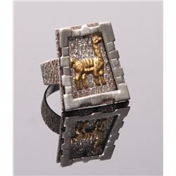 Sterling silver Lama ring with gold tone (not tested).