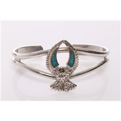 Sterling silver phoenix bangle with turquoise chips.  S