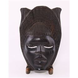African mask carved from ebony wood.  SIZE: see attache