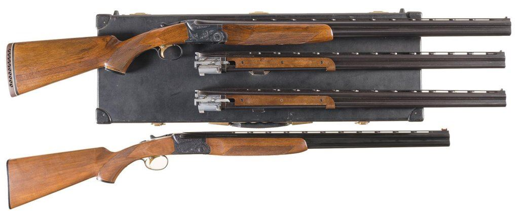 Two Over/Under Shotguns -A) Engraved Ithaca/SKB Three Barrel Set Model 600  Shotgun with Case