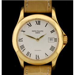 WATCH: 18ky Patek Phillipe for Tiffany & Co watch; white face, black roman numerals, date @ 3:00; ta