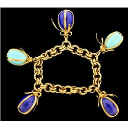 BRACELET: Ladies 18ky Schlumberger for Tiffany & Co bracelet; (3) lapis lazuli large egg charms, 20.