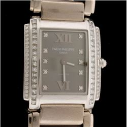 WATCH: 18kw Patek Phillipe for Tiffany & Co watch; (32) prn dias, 2.0mm =est. 1.50cttw, Ex/G/VS; (33