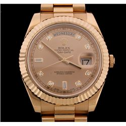 WATCH: [1] 18KRG gents Rolex Oyster Perpetual Day Date ll President watch with a champagne dial with