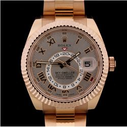 WATCH:  [1] 18Kt Everose Gold gents Rolex Oyster Perpetual Sky Dweller watch with a champagne dial,