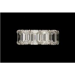 RING:  [1] Platinum eternity wedding band set with 13 emerald cut diamonds, approx. 13.75 cttw., exc