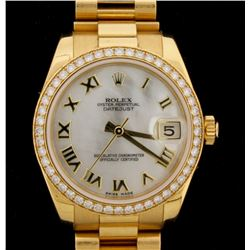 WATCH: [1] 18KYG ladies Rolex Oyster Perpetual DateJust watch with a white mother-of-pearl Roman dia