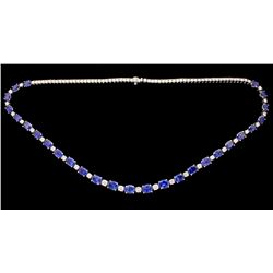 NECKLACE:  [1] 18KWG necklace set with 27 oval faceted blue sapphires, approx. 24.90 cttw., well mat