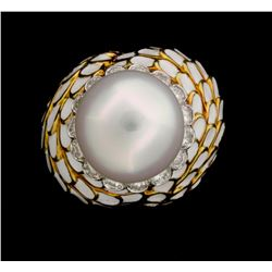 RING:  [1] 18KYG and platinum ring by David Webb with white enamel accents and set with a 14.5mm Sou