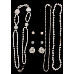 PEARLS: Lady's uniform strand necklace of white color Chinese freshwater pearls; out-of-round egg sh