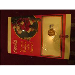 "17.5"" x 24"" ""Coca-Cola Santa Packs are Here"" Poster & 1886-1986 Coca-Cola Distributor Large Bronze M"