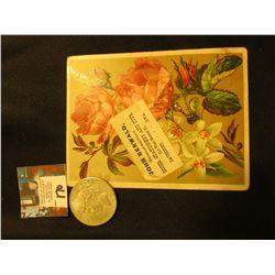 "1922 S U.S. Peace Silver Dollar, VF, & advertising card ""John Berwald…Davenport, Iowa."""