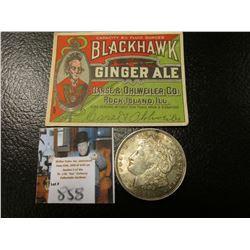 "1921 P Morgan Silver Dollar, EF & an Antique ""Blackhawk Ginger Ale…Rock Island, Ill."" Bottle label."
