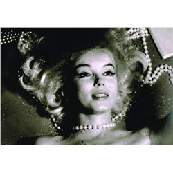 BERT STERN: MARILYN STRANGELED BY THE PEARLS.