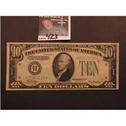Series 1934 A $10 Federal Reserve Note, obverse Macro G67, reverse Macro 844, VF.