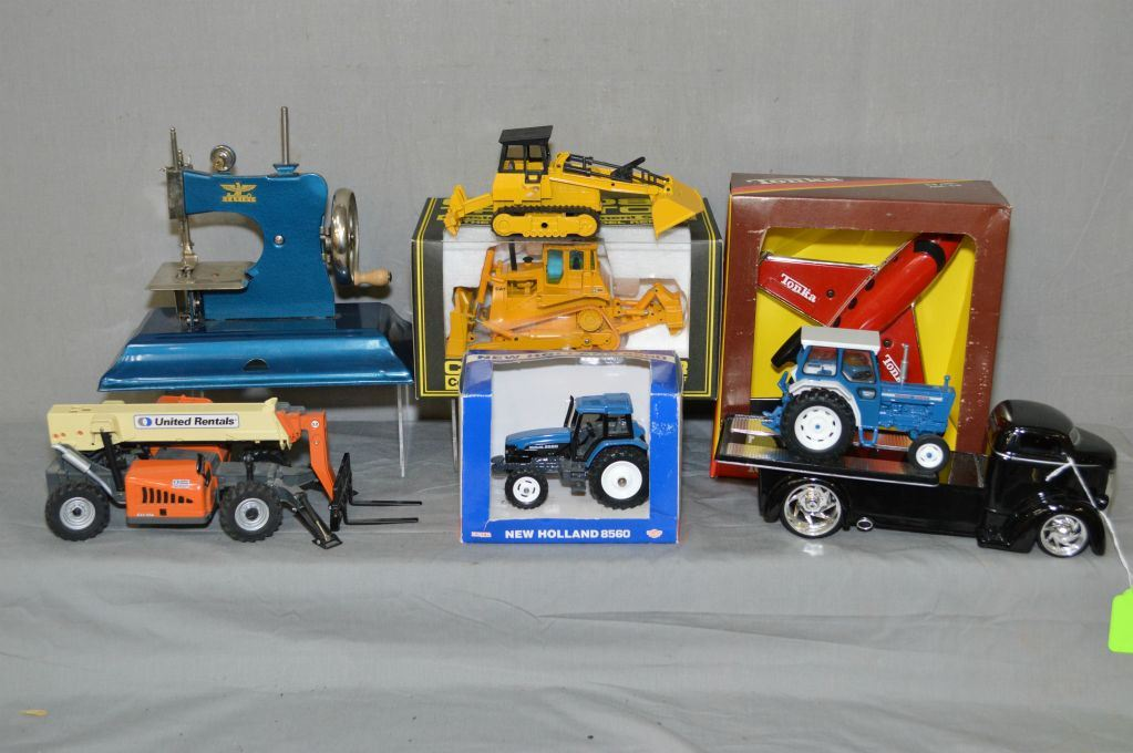Selection of collectibles including die-cast truck, tractors