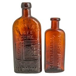 Two Warner's Safe Cure Bottles