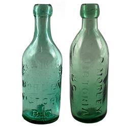 Two Morley Soda Bottles