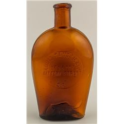 Louis Taussig & Co. Amber Whiskey Flask