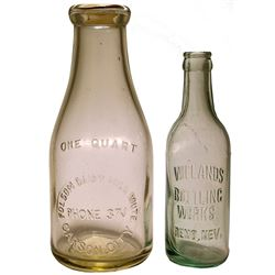 Two Different Embossed Nevada Bottles.