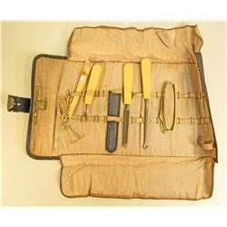 ANTIQUE BAKELITE MANICURE SET IN LEATHER ROLLED CASE