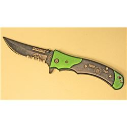 GREEN AND BLACK IRISH LUCK TAC FORCE SPRING ASSISTED FOLDING KNIFE