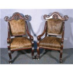 PAIR ANTIQUE CARVED WOOD AND ANIMAL HIDE ARMCHAIRS