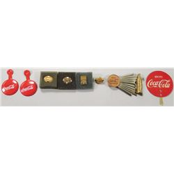Collection of Coca Cola Pins and Buttons