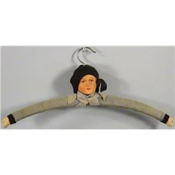 Early Figural Display Hanger