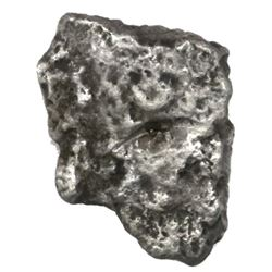 """Silver """"plata corriente"""" cut piece of a """"splash"""" ingot, marked with one tax stamp, 23.66 grams."""