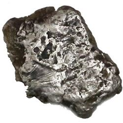 Silver  plata corriente  cut piece of a  splash  ingot, marked with one tax stamp, 18.71 grams.