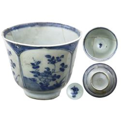 Shipwreck: Chinese blue-on-white porcelain cup, Kangxi period, 4-paneled floral design
