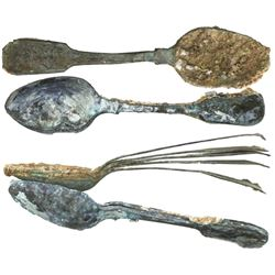Two clumps of copper-alloy spoons (encrusted as found), 10 spoons total.