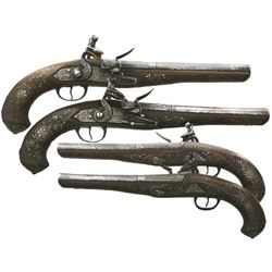 Pair of flintlock officers' pistols with engraved silver mounts, 1700s.