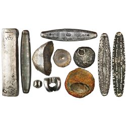Collection of 11 pieces of silver primitive money from southeast Asia (1200s to 1800s), consisting o