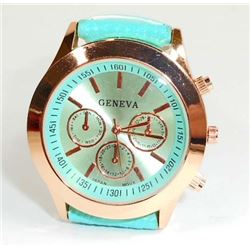 WOMANS WATCH W/ TURQUOISE BAND