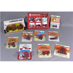 GROUP OF ERTL TRACTORS AND IMPLIMENTS