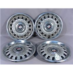 SET OF FOUR VINTAGE BUICK HUBCAPS