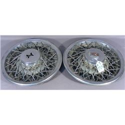 TWO VINTAGE OLDMOBILE WIRE WHEEL COVERS