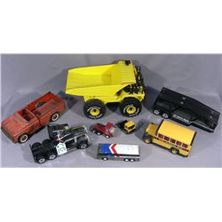 GROUP OF VINTAGE BUDDY L TRUCKS AND BUSES