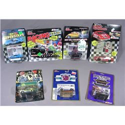 SET OF SEVEN RACING CHAMPIONS  RACE CARS