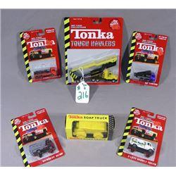 BOX LOT OF SIX DIE CAST TONKA TRUCKS BY MAISTO