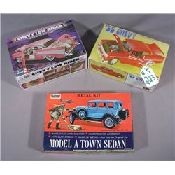 THREE OPENED MODEL CARS IN ORIGINAL BOXES