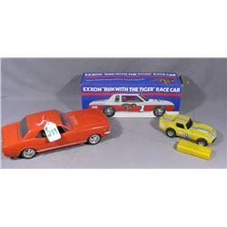 THREE PLASTIC CARS