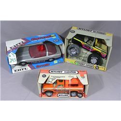 THREE BOXED VINTAGE NYLINT TRUCKS & CARS