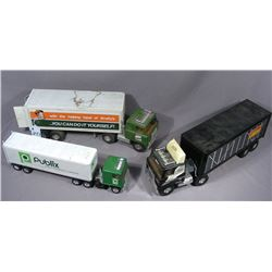 THREE VINTAGE ERTL SEMI TRUCKS WITH TRAILERS