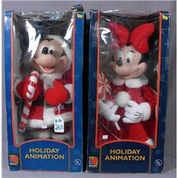 A PAIR OF HOLIDAY ANNIMATION MICKEY AND MINNIE DOLS